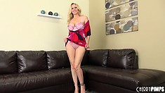 Buxom blonde Julia Ann chats on the couch and gets naked to diddle