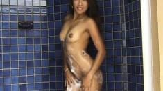 Wild Oriental beauty Raquel displays her wonderful body in the shower