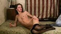Sexy slim Ganya puts on her black pantyhose and pleases her needy twat