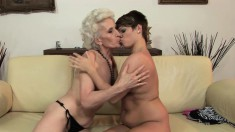 Lusty grandma moans while having her twat licked by a younger lesbian