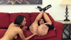 Two Irresistible Lesbians Enjoying A Frenzy Of Sex Toys On The Couch