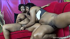 Fat lezzos and their rubber friend in a steamy girl-on-girl sex shoot