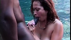 Asian babe, Saki, is in the pool blowing his long black cock