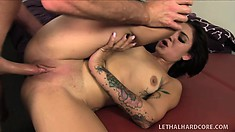 Adorable tattooed brunette Aimee Black wildly fucks that hard rod all over the couch