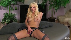 This blondie's sexy tights make her already perfect body even more seductive