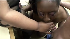Two chunky dark skinned babes take turns sucking and stroking a stiff prick