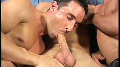 Hot stud sucks two big cocks and gets his face covered with warm jizz