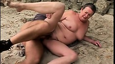 Chubby granny gets on her knees at the beach and blows then gets banged