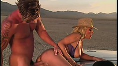 Blonde cowgirl gets her tight bald cunt fucked out in the desert