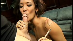 Fine Asian nympho gives her boss a blowjob and handjob combo