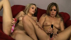 Sultry blonde lesbians use their tongues and a dildo to make each other cum hard