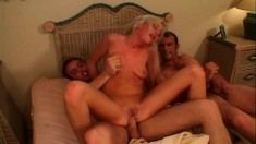 Trashy blonde Hillary Spank has two guys banging her holes on the bed