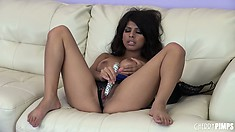 She moves over her panties so she can start putting her dildo in