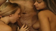 Two ladies mack out on each other and then go for his pecker