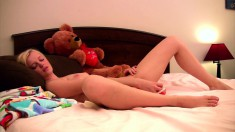 Tatyana uses her red dildo with legs spread wide open on the bed