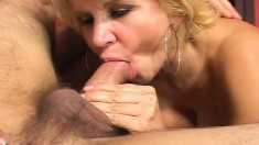 Cock-hungry blonde broad takes two throbbing love rods in her hands