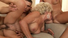 Lusty young blonde licks this cougar's pussy while getting fucked in the ass