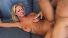 Stacked and lustful blonde hangs on for a hard pounding on the couch