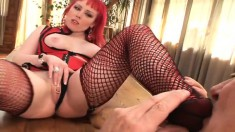 Redheaded dominatrix makes him fulfill her foot fetish and then fuck her