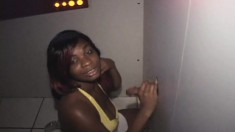 Nasty ebony babe gets all her holes filled with cum at the gloryhole
