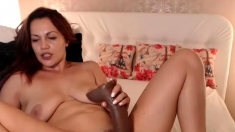 Brunette amateur milf with webcam on couch