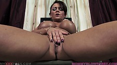 She sits in the chair sliding two fingers in her pussy making her cum