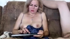 Mature British lady in stockings fucking a young guy