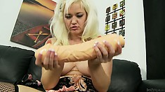 Blonde in fishnets uses her big toys to plow a furrow in her pussy