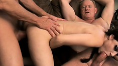 Cute young brunette with pigtails Sasha Grey gets fucked by two horny older guys