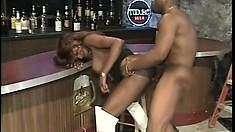 Ebony hottie Africa Martin blows the barman's black rod and then gets fucked hard