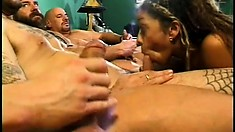 Sexy black chick keeps herself busy with a whole line of cocks