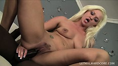 Stacked blonde Whitney Grace enjoys the intense pleasure a black rod has to offer