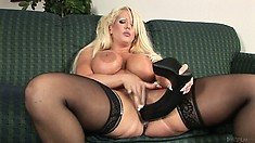 This blonde MILF slut likes all things big including her fake tits and sex toys