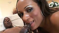 Curvaceous ebony girl Mya has a black stud drilling her peach like she deserves