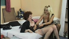 Experienced lesbian pussy-munchers have fun drilling each other with a strap-on