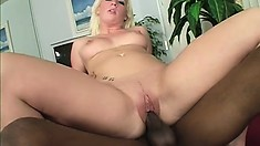 Pale white blonde with a big booty has a huge black shaft drilling her tight pussy