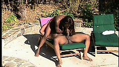 Ebony hottie spreads her legs to get her pussy pounded outdoors
