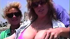 Busty vixens getting down and dirty with one guy in a retro porn vid