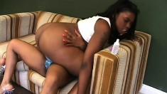 Filthy ebony lesbians make each other cum with a big strap-on