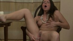 Geneva lets you take a peek at her as she enjoys her sex toy