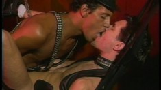 Leather club gays get freaky with each other on the sex swing