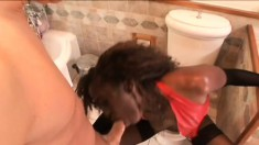Black beauty pleases a white cock with her hot lips and her sexy feet