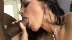 Raven haired mom slipping her pussy onto some meaty black dick